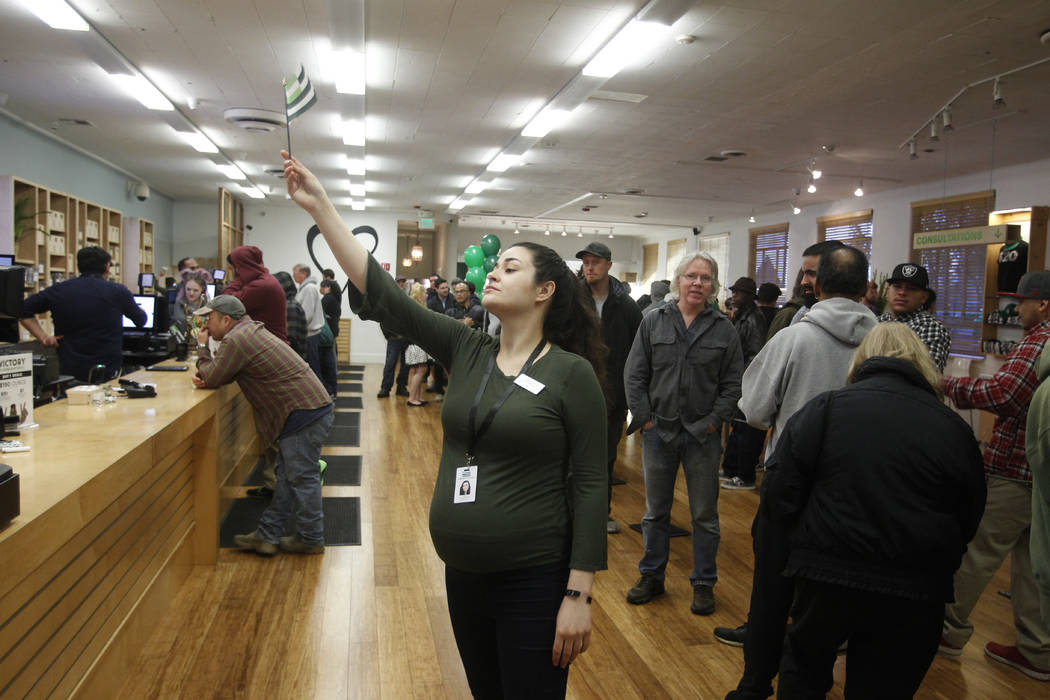 Sally Sanchez calls for the next customer at Harborside marijuana dispensary, Monday, Jan. 1, 2018, in Oakland, Calif. Starting New Year's Day, recreational marijuana can be sold legally in Califo ...