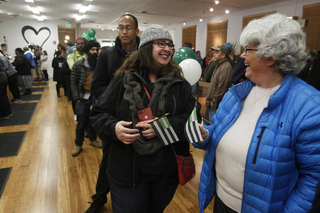 Margot Simpson, right, and Diana Gladden wait in line to purchase marijuana at Harborside marijuana dispensary, Monday, Jan. 1, 2018, in Oakland, Calif. Starting New Year's Day, recreational marij ...