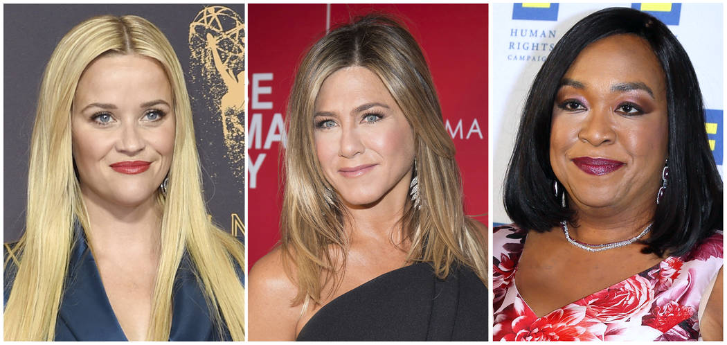 """FILE- This combination of file photos show actresses Reese Witherspoon at the 69th Primetime Emmy Awards in Los Angeles, left, Jennifer Aniston at a screening of """"Office Christmas Party"""" in New Yo ..."""
