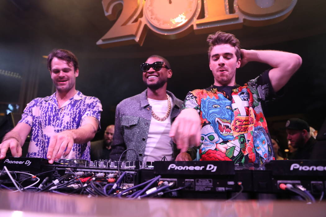 Usher is shown with The Chainsmokers at XS Nightclub at Wynn Las Vegas on Dec. 31, 2017 (Danny Mahoney)