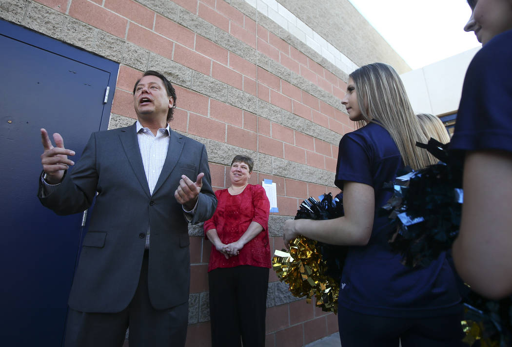 Clark County School District Superintendent Pat Skorkowsky, left, and Clark County School Board District Trustee Deanna Wright talk with members of the marching band, dance and cheerleading progra ...