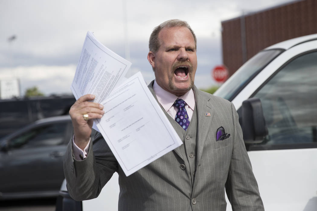 Clark County School District Board trustee Kevin Child attends a rally for affordable health insurance with teachers and supporters May 17, 2017, outside of the Clark County School District Educat ...