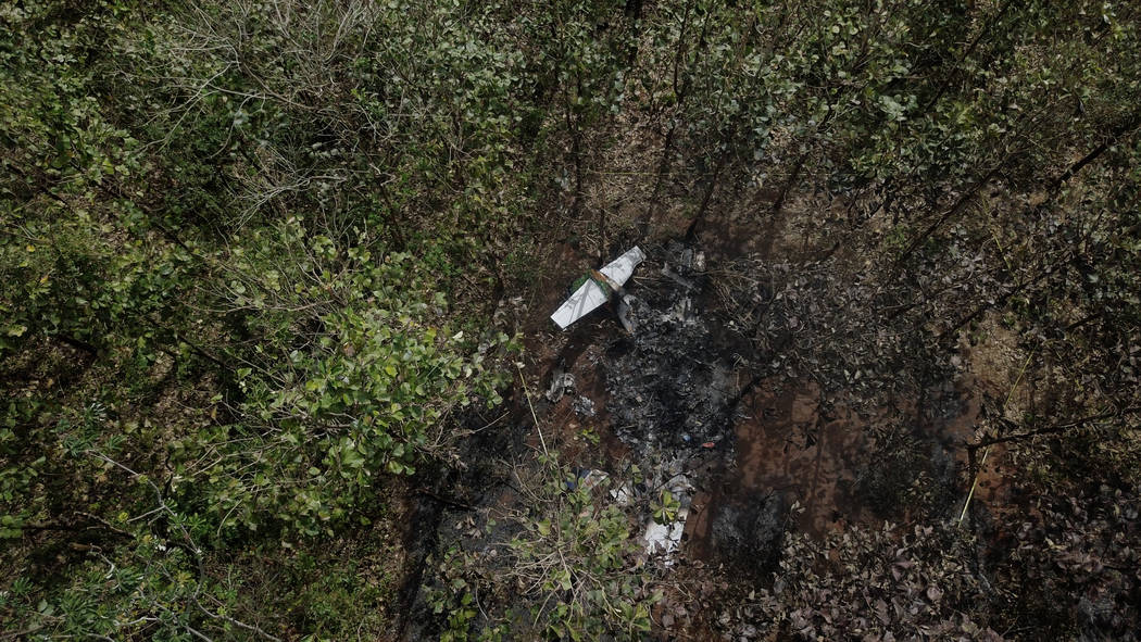 The burnt wreckage of a Nature Air plane is seen in a wooded area in Corozalito de Nandayure, near Punta Islita, Guanacaste province, Costa Rica, Monday, Jan. 1, 2018. Costa Rican investigators ar ...