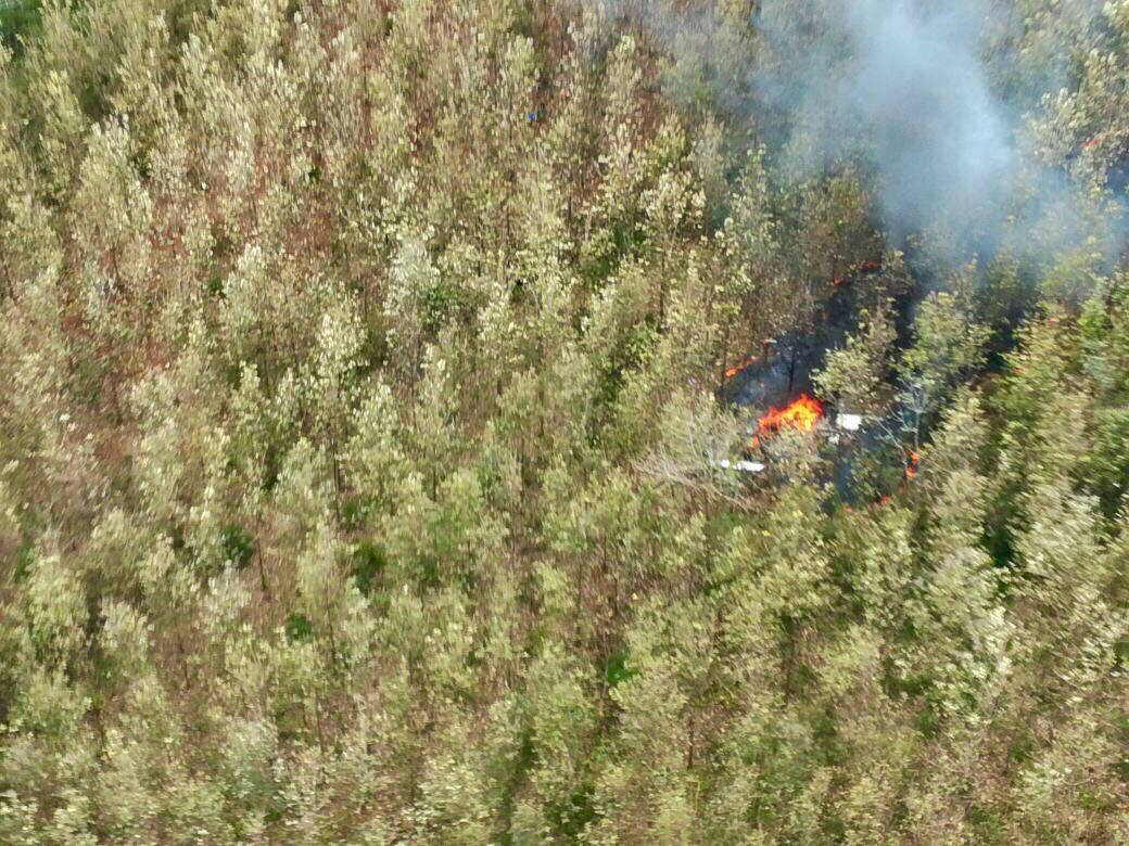 This photo released by Costa Rica's Public Safety Ministry shows smoke rising from the site of a plane crash in Punta Islita, Guanacaste, Costa Rica, Sunday, Dec. 31, 2017. A government statement  ...