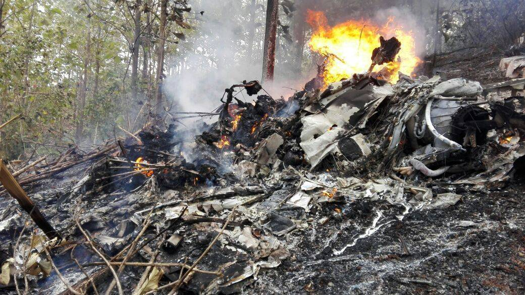 This photo released by Costa Rica's Civil Aviation press office shows the site of a plane crash in Punta Islita, Guanacaste, Costa Rica, Sunday, Dec. 31, 2017. A government statement says there we ...