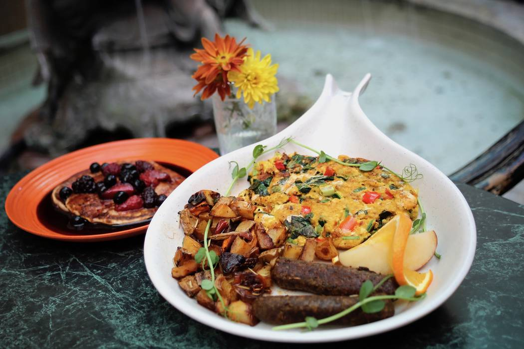 """The """"Breakfeast"""" platter at Go Vegan Cafe on South Rainbow Boulevard includes a tofu scramble, potatoes, sausage and pancakes. Customers can choose the style of their scramble and pancake toppings ..."""