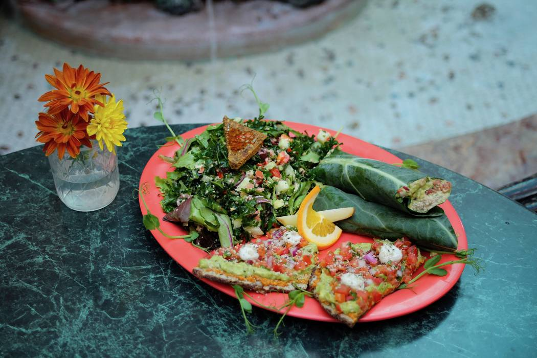 "The ""Rawfeast"" platter at Go Vegan Cafe on South Rainbow Boulevard includes a side salad, half tostada and a half wrap. Customers can choose their flavor profile ($15). (Courtesy Go Vegan Cafe)"