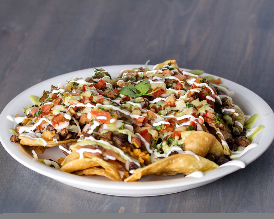Loaded Nachos from Pancho's Kitchen a bed of chips with rice, beans, pico de gallo, avocado sauce, sour cream, organic coconut oil-based cheese and mixture of grilled veggies. (Pancho's Kitchen)