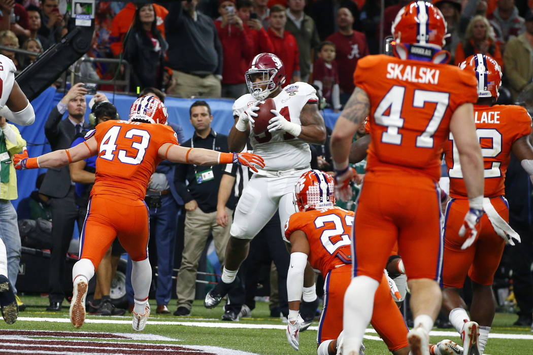 Alabama defensive lineman Da'Ron Payne (94), who was used on an offensive play, pulls in a touchdown reception in the second half of the Sugar Bowl semi-final playoff game against Clemson for the  ...