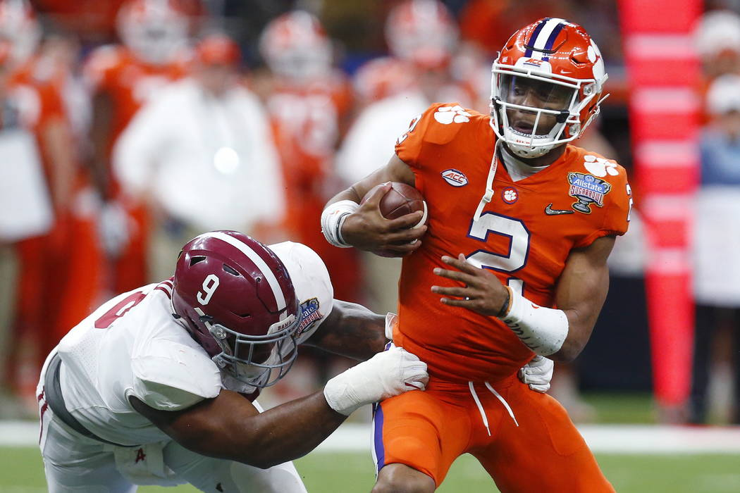 Clemson quarterback Kelly Bryant (2) is sacked by Alabama defensive lineman Da'Shawn Hand (9) in the second half of the Sugar Bowl semi-final playoff game for the NCAA college football national ch ...