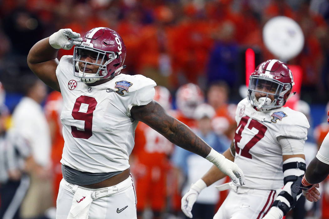 Alabama defensive lineman Da'Shawn Hand (9) celebrates his sack in the second half of the Sugar Bowl semi-final playoff game against Clemson for the NCAA college football national championship, in ...