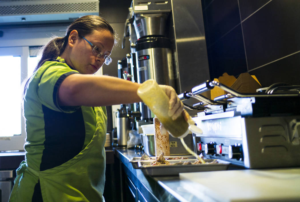 Chef Maritza Purcell, owner and operator of Food Junky, prepares barbacoa and carnitas inside Inspire Theater in downtown Las Vegas on Friday, Dec. 29, 2017. Food Junky, which recently began opera ...