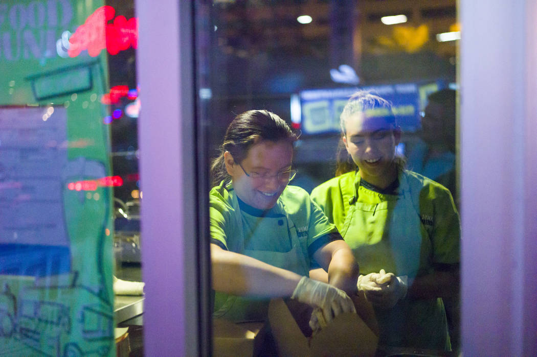 Chef Maritza Purcell, owner and operator of Food Junky, left, and sous chef Jaimie Fisher prepare a meal inside Inspire Theater in downtown Las Vegas on Friday, Dec. 29, 2017. Food Junky, which re ...