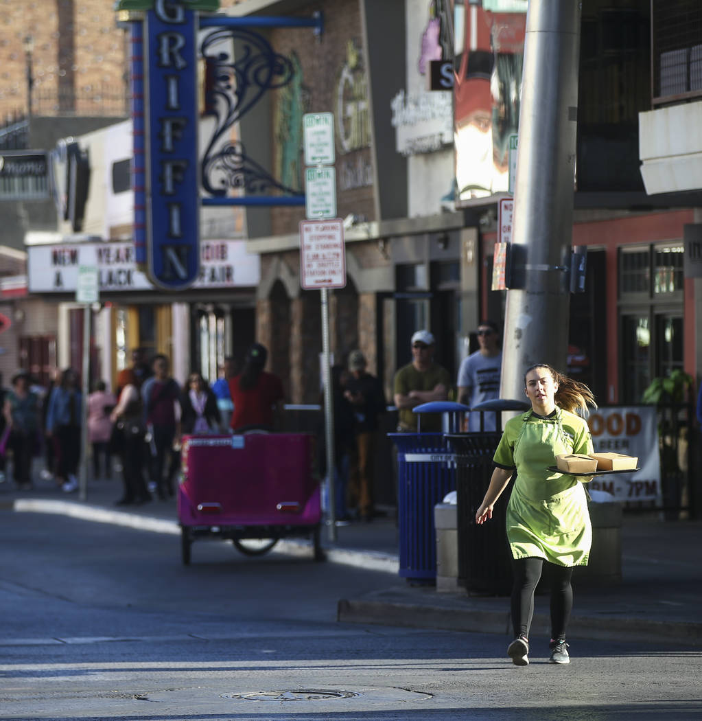 Sous chef Jaimie Fisher of Food Junky takes a delivery across Las Vegas Boulevard to Banger Brewing in downtown Las Vegas on Friday, Dec. 29, 2017. Food Junky, which recently began operating out o ...