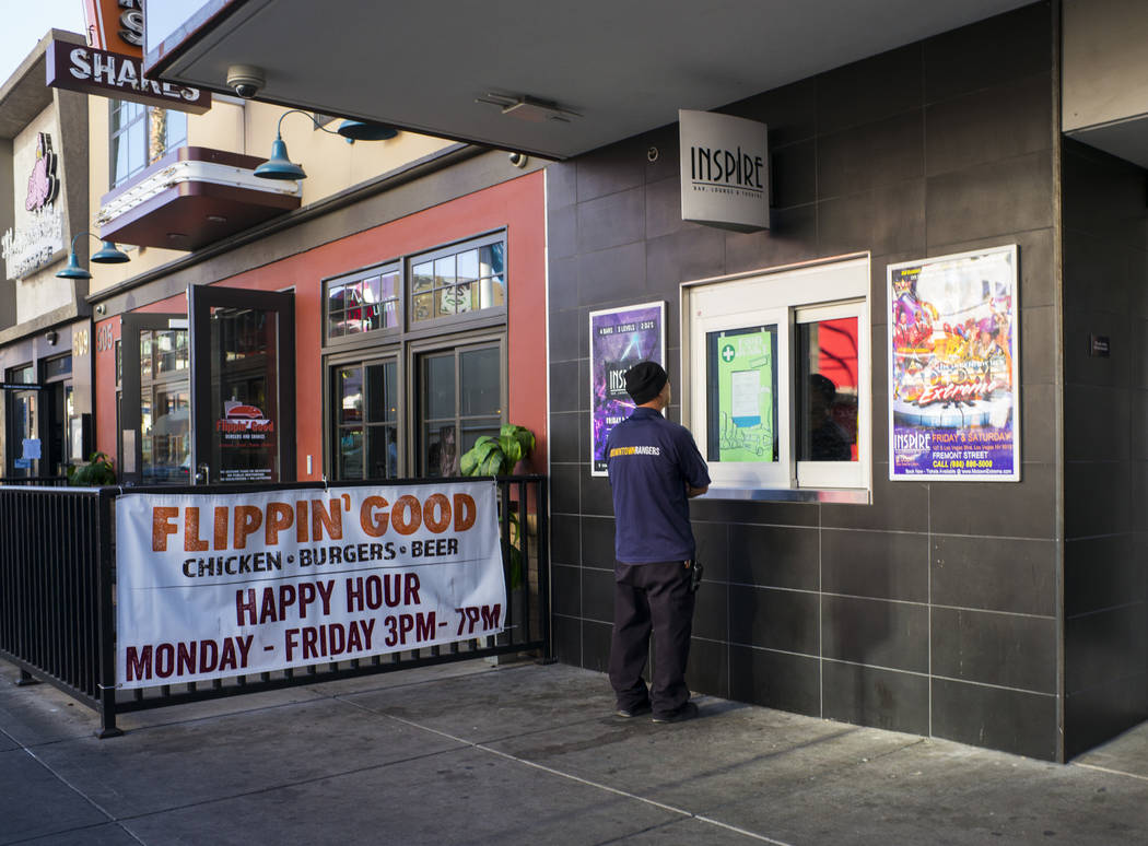 A Downtown Ranger checks the menu for Food Junky at Inspire Theater in downtown Las Vegas on Friday, Dec. 29, 2017. Food Junky, which recently began operating out of Inspire, delivers food to patr ...