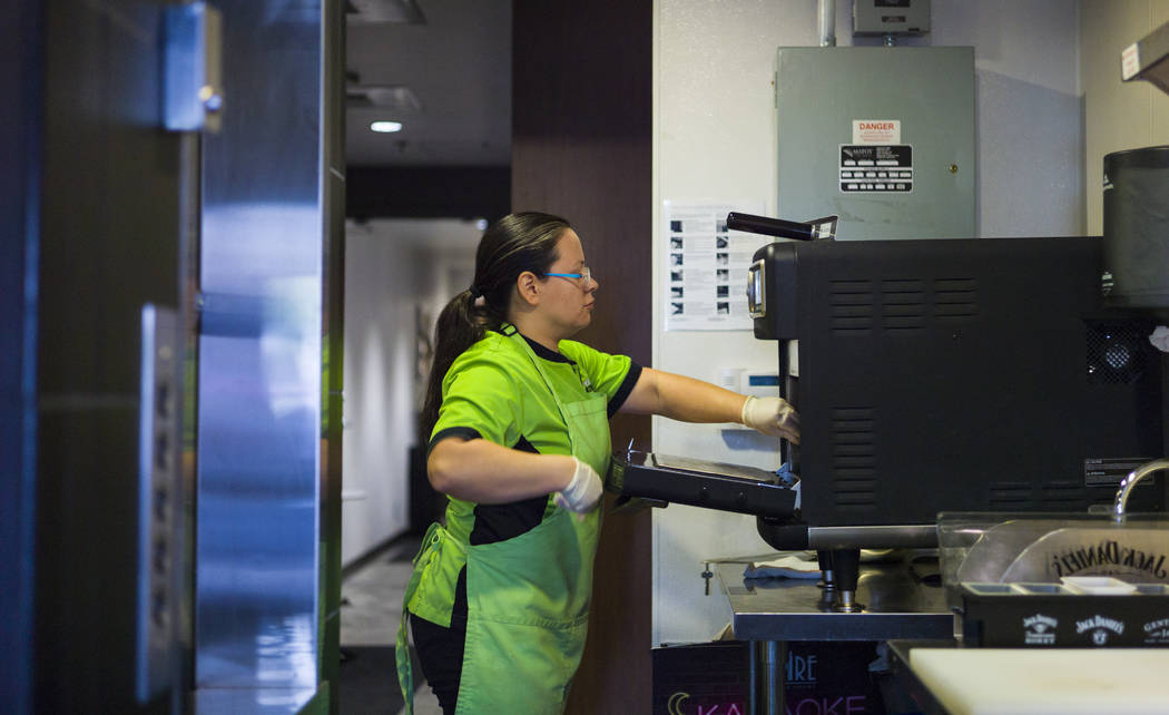 Chef Maritza Purcell, owner and operator of Food Junky, prepares food inside Inspire Theater in downtown Las Vegas on Friday, Dec. 29, 2017. Food Junky, which recently began operating out of Inspi ...