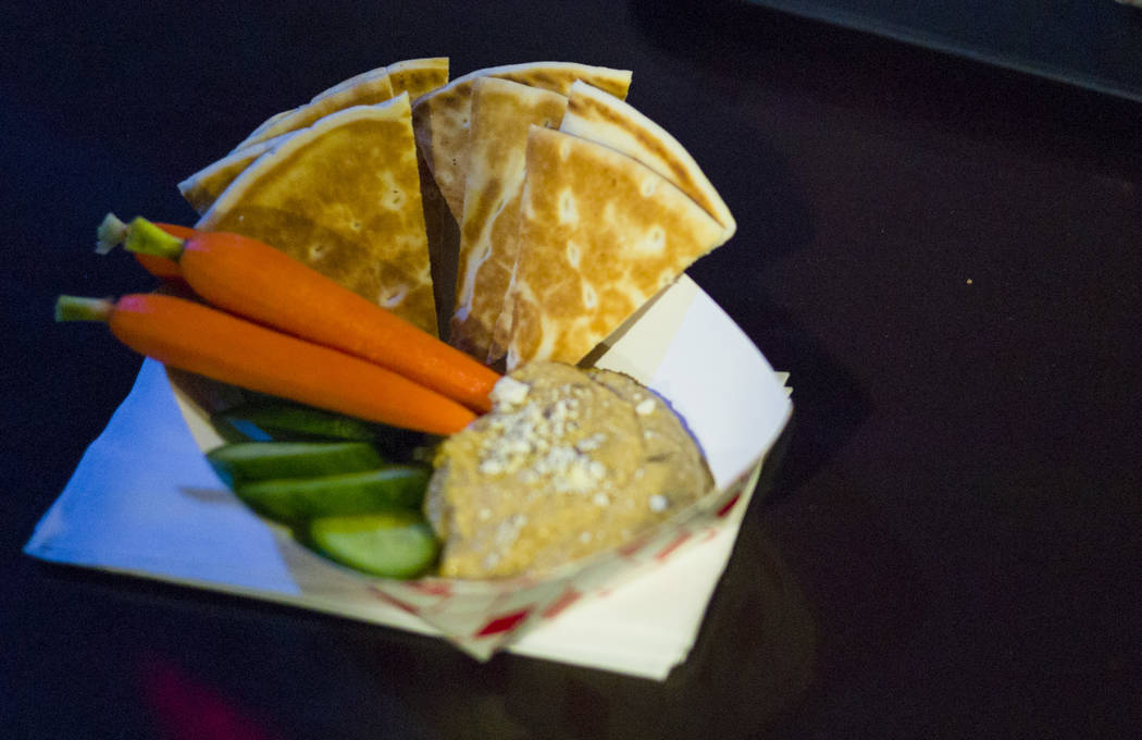 Pita bread and hummus at Food Junky inside Inspire Theater in downtown Las Vegas on Friday, Dec. 29, 2017. Food Junky, which recently began operating out of Inspire, delivers food to patrons at ne ...