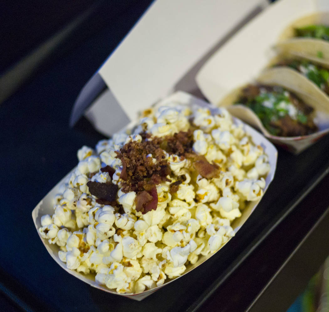 Popcorn with bacon bits at Food Junky inside Inspire Theater in downtown Las Vegas on Friday, Dec. 29, 2017. Food Junky, which recently began operating out of Inspire, delivers food to patrons at  ...