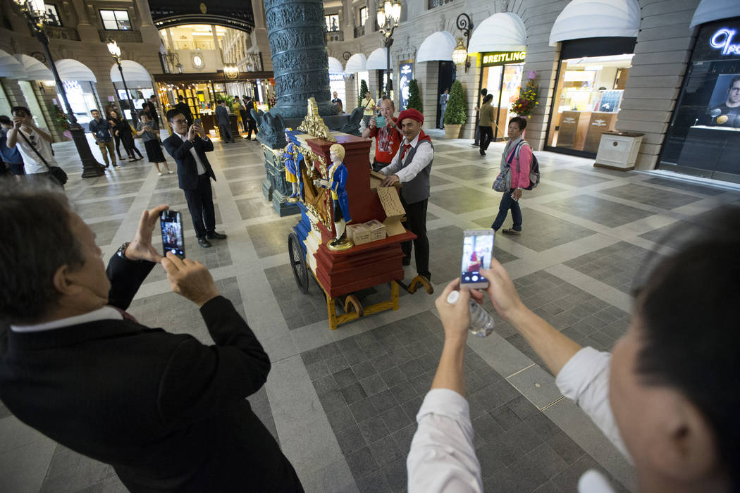 People photograph a music player inside the Parisian Macao hotel-casino on Wednesday, Sept. 14, 2016, in Macau. Erik Verduzco/Las Vegas Review-Journal Follow @Erik_Verduzco