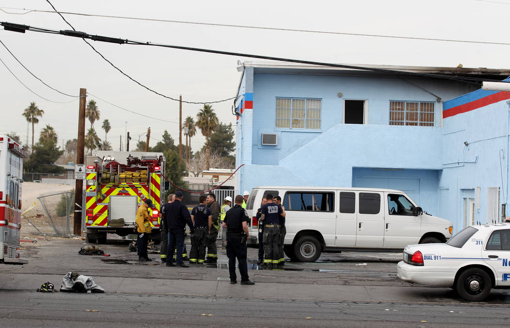 North Las Vegas firefighters investigate a fire at an abandoned building at 2055 Las Vegas Blvd. North near East Lake Mead Boulevard that killed one person and injured three others, Tuesday, Jan.  ...