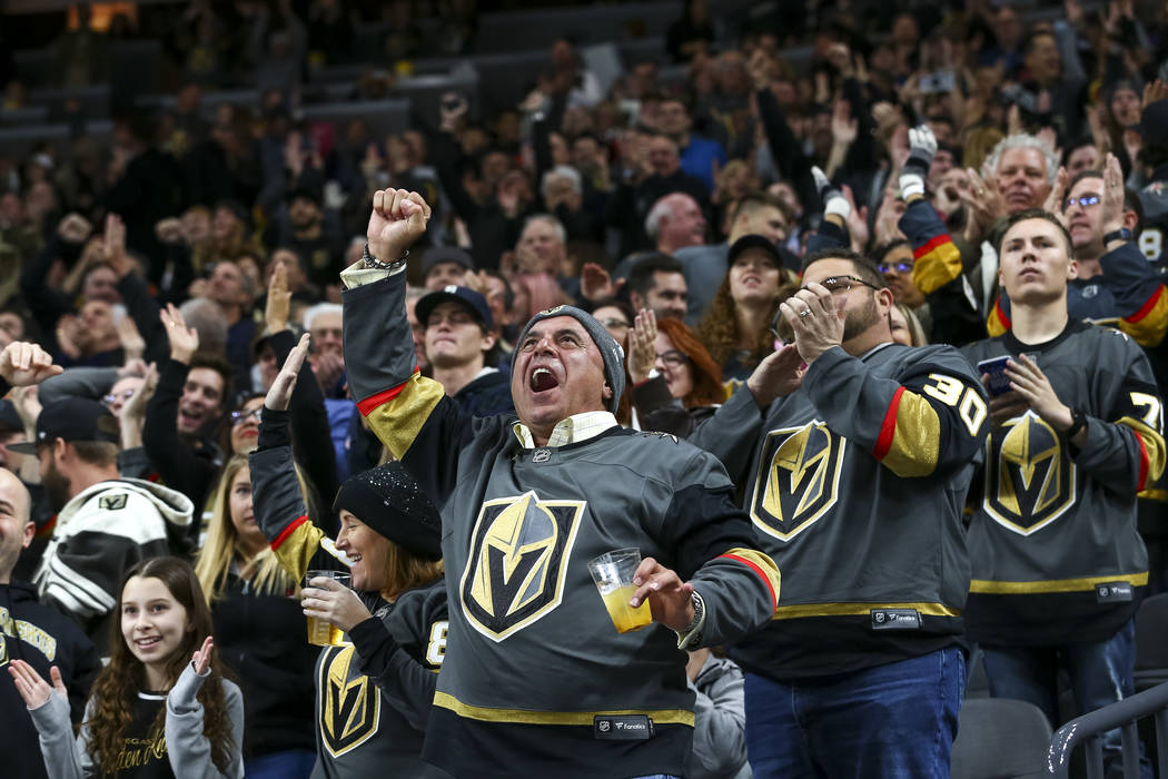 Vegas Golden Knights fans celebrate a goal by Knights defenseman Shea Theodore (27) during the second period of an NHL hockey game between the Vegas Golden Knights and the Nashville Predators at t ...