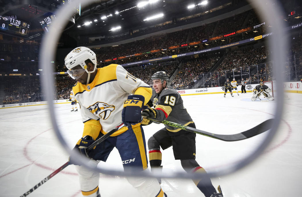 Nashville Predators defenseman P.K. Subban (76) and Vegas Golden Knights right wing Reilly Smith (19) vie for the puck during the second period of an NHL hockey game between the Vegas Golden Knigh ...