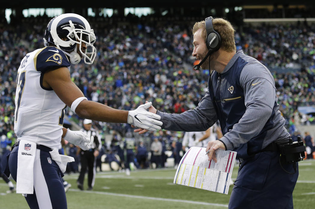 Los Angeles Rams head coach Sean McVay, right, greets wide receiver Robert Woods, left, after Rams' Todd Gurley scored a touchdown in the first half of an NFL football game, Sunday, Dec. 17, 2017, ...