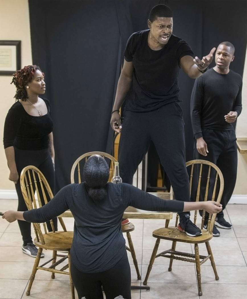 "John Joseph, middle, works through a scene with fellow cast members during rehearsal for ""A Raisin in the Sun"" on Wednesday, January 3, 2018, at First African Methodist Episcopal ..."