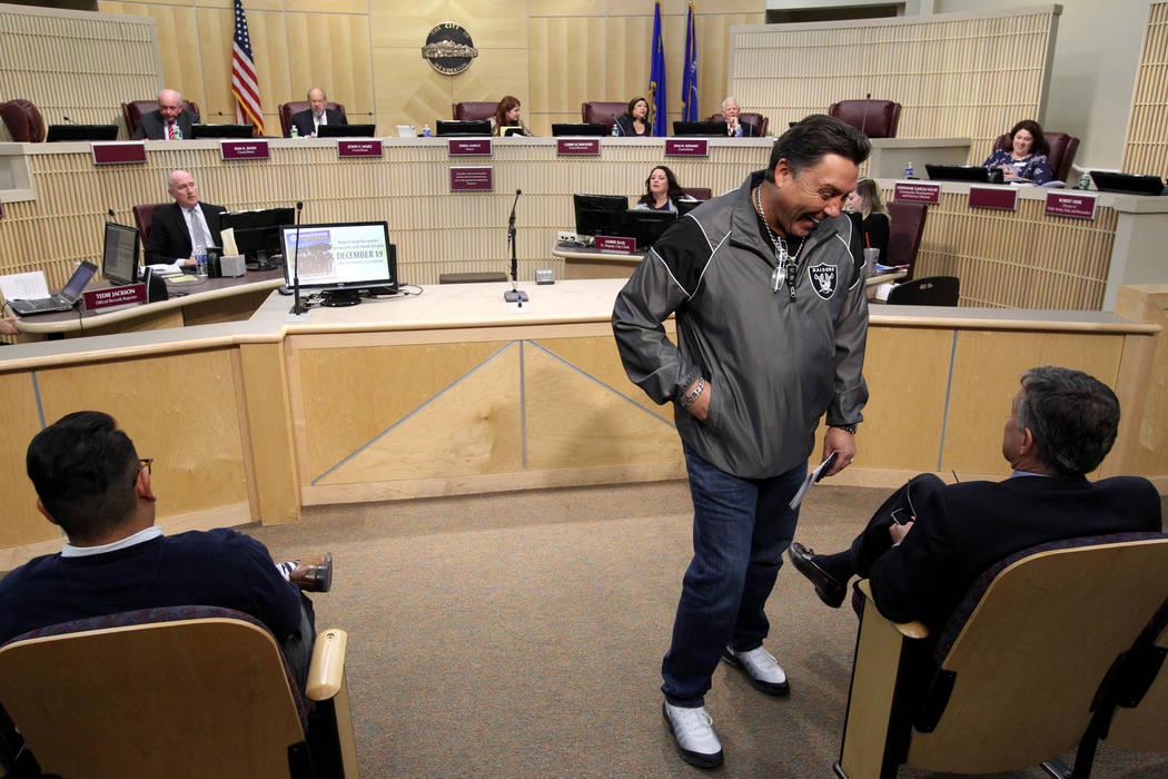 Tommy White, of the Labors Local 872 and member of the Las Vegas Stadium Authority Board, left, visits with Las Vegas Stadium Company Chief Operating Officer Don Webb before a Henderson City Counc ...