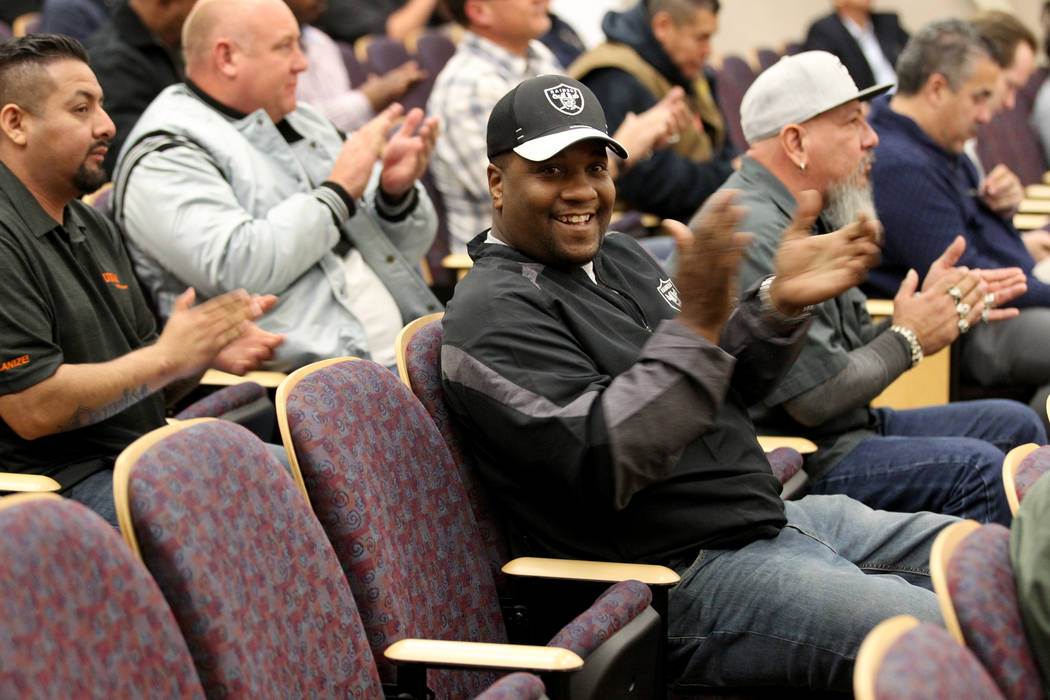 Raiders fans, including Ken McLin, center, applaud after the Henderson City Council voted to to sell 55 acres to the NFL team for half the landճ appraised value Tuesday, Jan. 2, 2018. K.M. C ...