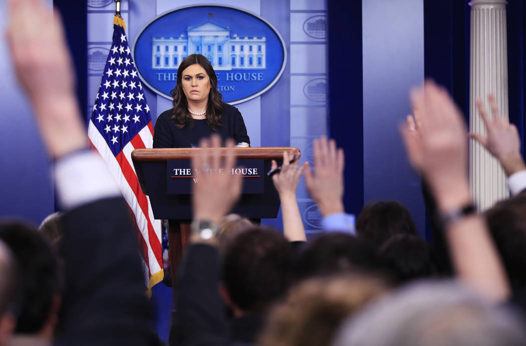 White House press secretary Sarah Huckabee Sanders talks to reporters during the daily press briefing in the Brady press briefing room at the White House, in Washington, Tuesday, Jan. 2, 2018. (AP ...