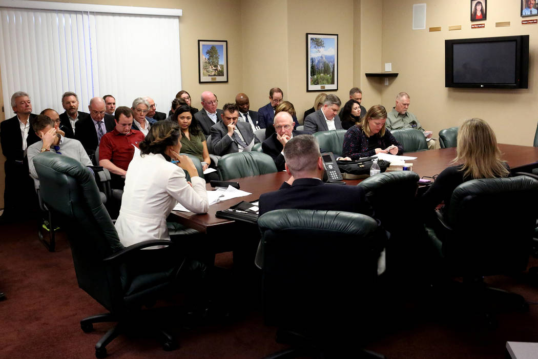 Medical professionals pack a small conference room at the offices of the Nevada State Board of Dental Examiners in Las Vegas on Wednesday, Jan. 3, 2018 to express concerns about proposed regulatio ...