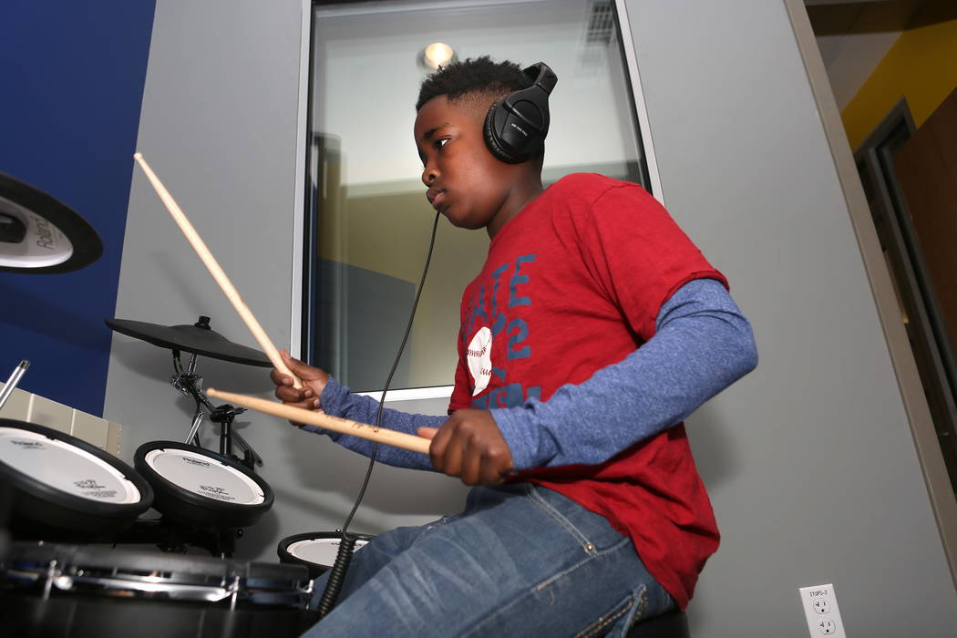 Frank Williamson, 13, plays on a Roland electronic drum kit on Tuesday, Jan. 2, 2018, which is available for kids as part of Tech Tuesdays at the Clark County Library and gives kids access to high ...
