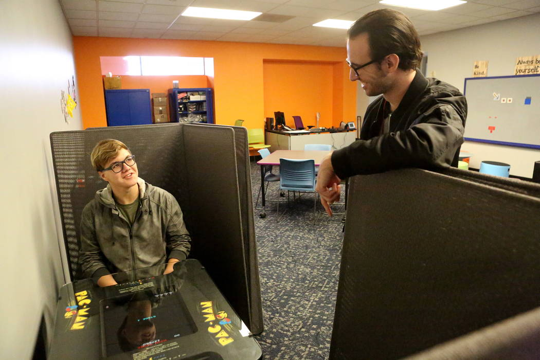 Steven McEntire, 16, left, chats with Teen Service Specialist Jake Duncan, 25, about Pac-Man, one of the many video games available at the Clark County Library's Teen Tech Center which give ...