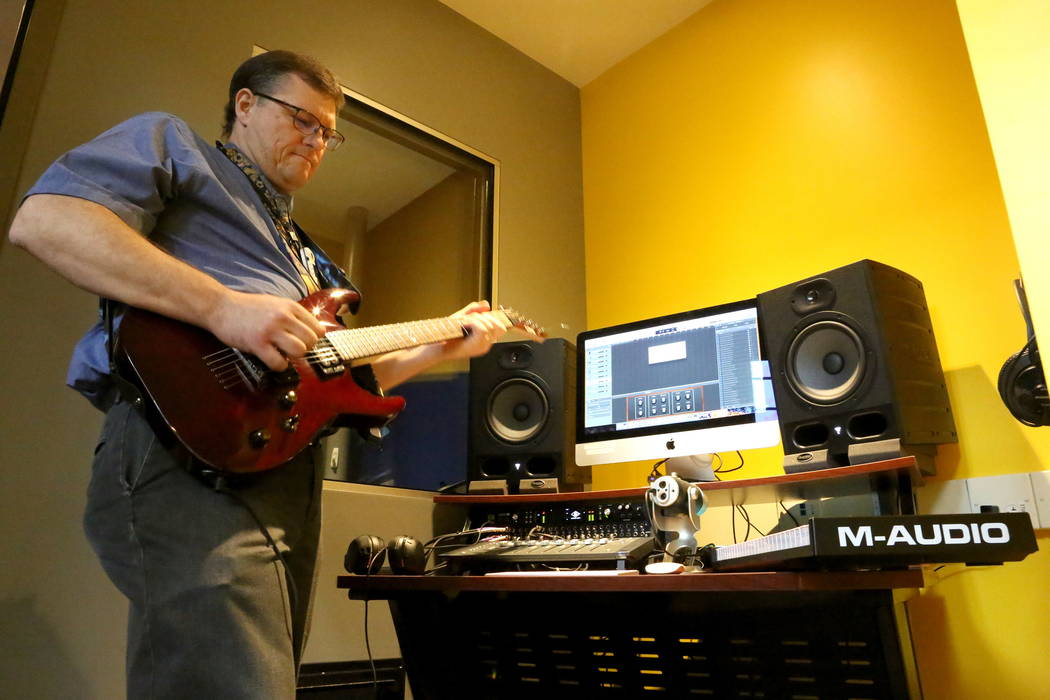 Adult Services Librarian Demosthenes Papaeliou takes advantage of the small recording studio at the Clark County Library's Teen Tech Center which gives kids access to high-tech electronics  ...