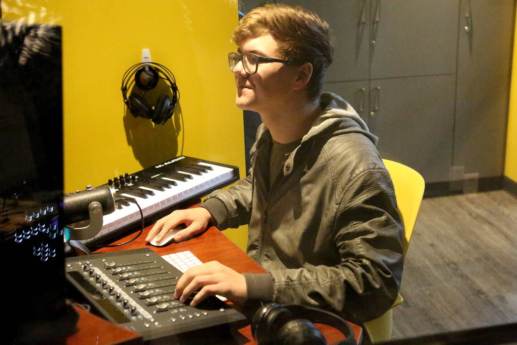 Steven McEntire, 16, takes advantage of the small recording studio at the Clark County Library's Teen Tech Center which gives kids access to high-tech electronics and other materials with a ...