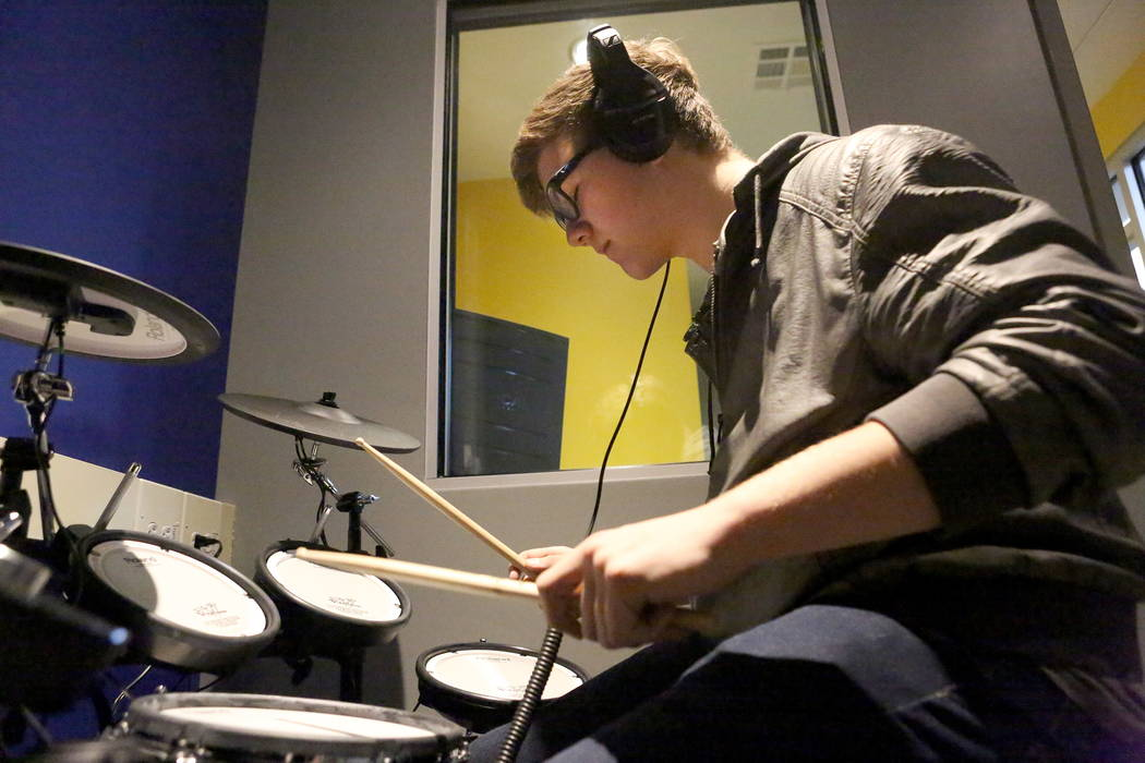 Steven McEntire, 16, plays on a Roland electronic drum kit on Tuesday, Jan. 2, 2018, at the Clark County Library's Teen Tech Center and gives kids access to high-tech electronics and other  ...