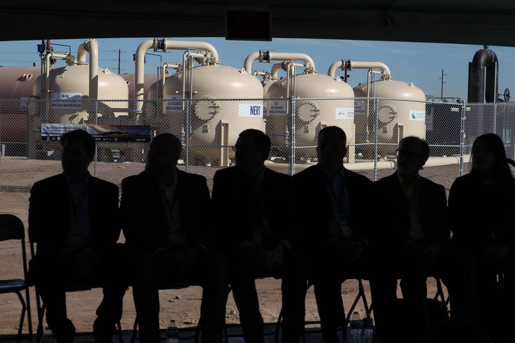 Dignitaries wait to speak during a ceremony to mark completion of construction on a groundwater extraction and treatment system near the Pabco Trailhead at the Las Vegas Wash Thursday, Jan. 4, 201 ...