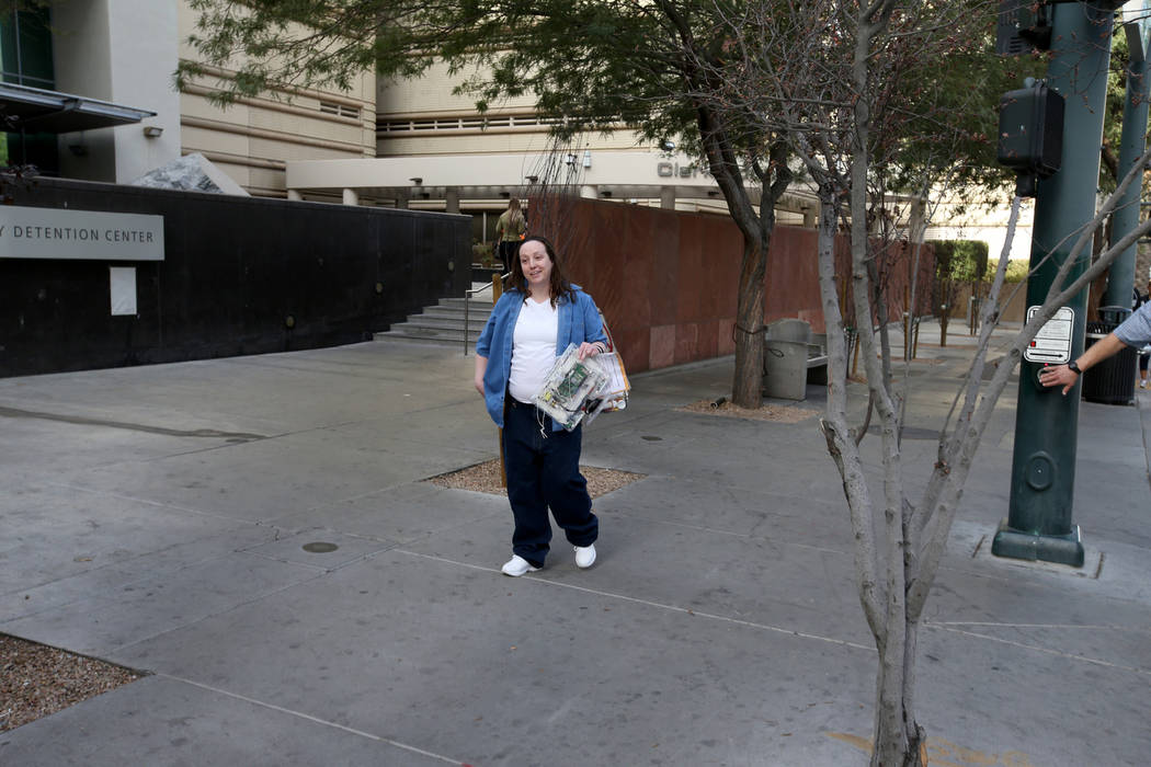 Kirstin Lobato, 35, who spent more 16 years incarcerated for the killing of a homeless man whose penis was cut off, waits for loved ones after walking out of Clark County Detention Center in Las V ...