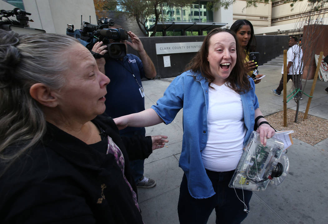 Kirstin Lobato, 35, who spent more 16 years incarcerated for the killing of a homeless man whose penis was cut off, reacts to loved ones after walking out of Clark County Detention Center in Las V ...