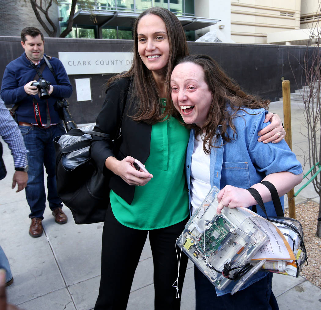 Kirstin Lobato, 35, who spent more 16 years incarcerated for the killing of a homeless man whose penis was cut off, gets a hug from Jane Pucher, and attorney with the Innocence Project, after walk ...