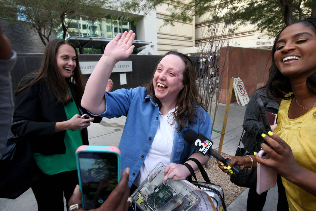 Kirstin Lobato, 35, who spent more 16 years incarcerated for the killing of a homeless man whose penis was cut off, greets supporters after walking out of Clark County Detention Center in Las Vega ...