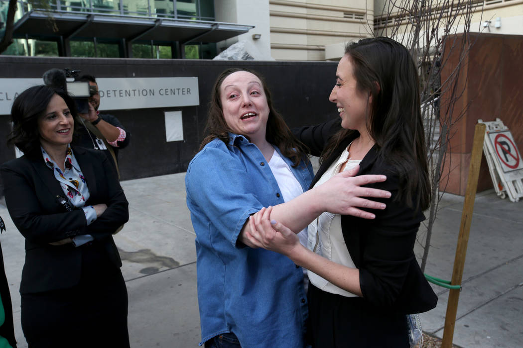Kirstin Lobato, 35, who spent more 16 years incarcerated for the killing of a homeless man whose penis was cut off, hugs Melissa Sopher, a paralegal at the Innocence Project, after walking out of  ...