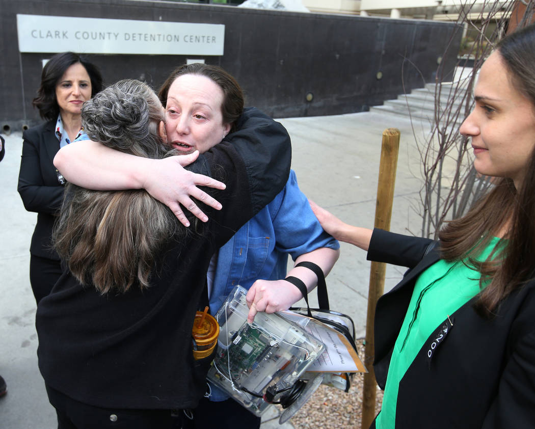 Kirstin Lobato, 35, who spent more 16 years incarcerated for the killing of a homeless man whose penis was cut off, hugs Michelle Ravell after walking out of Clark County Detention Center in Las V ...