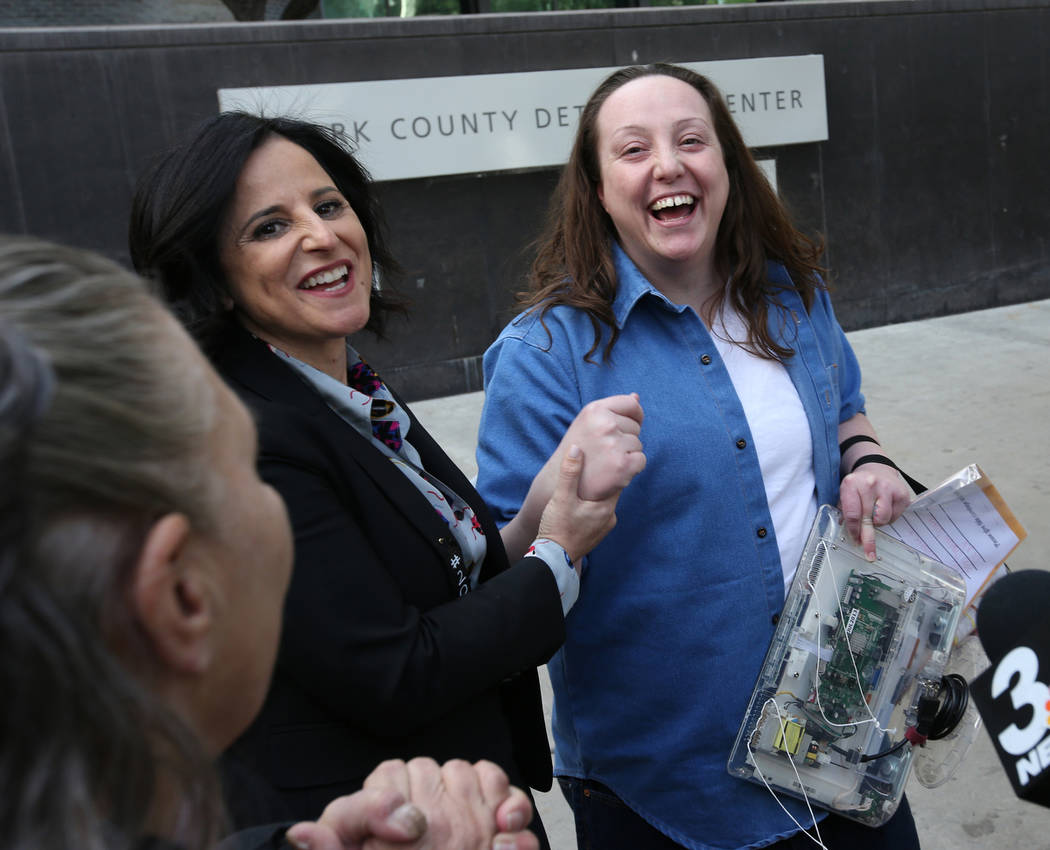 Kirstin Lobato, 35, who spent more 16 years incarcerated for the killing of a homeless man whose penis was cut off, greets Michelle Ravell, left, and Vanessa Potkin an attorney with the Innocence  ...