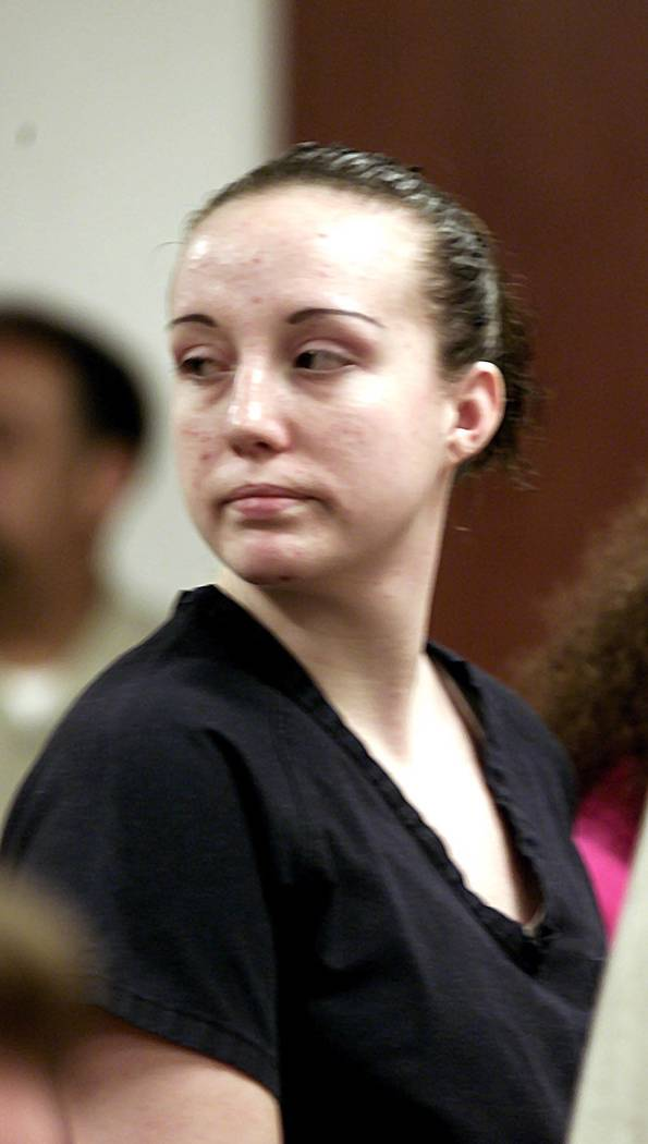 Kirstin Lobato, then 19, turns toward her family after being sentenced on Aug. 28, 2002, to at least 40 years in prison for the killing and mutilation of a homeless man. Las Vegas Review-Journal f ...