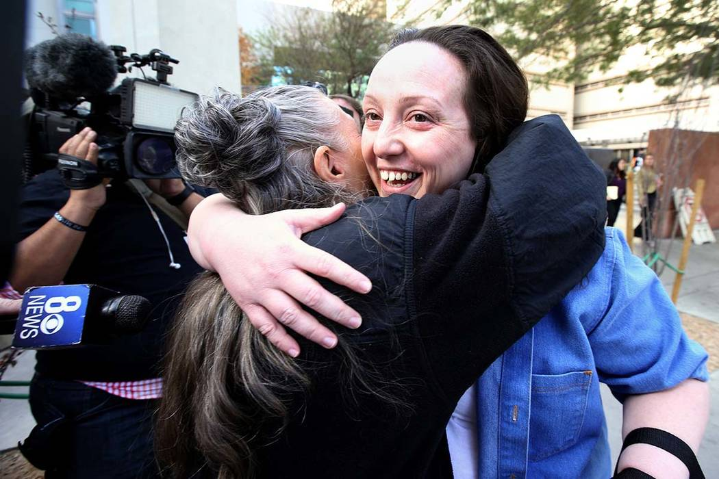 Kirstin Lobato, 35, who spent more than 16 years incarcerated for the killing of a homeless man whose penis was cut off, hugs close friend Michelle Ravell after her release from the Clark County D ...
