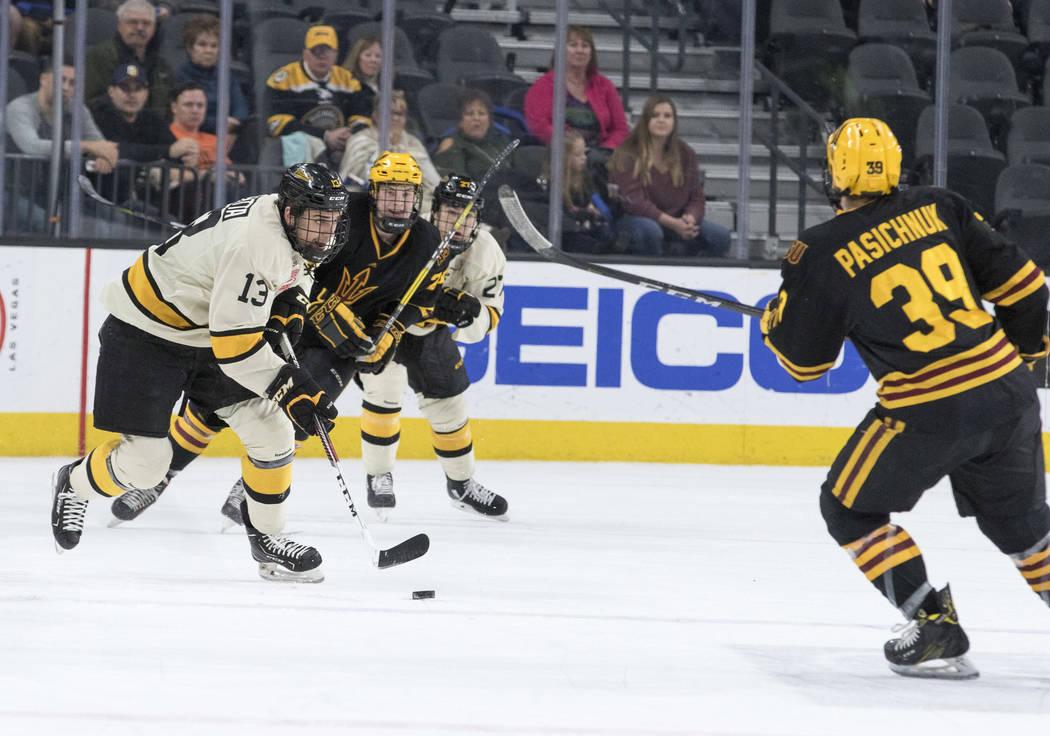 Michigan Tech Huskies forward Thomas Beretta (13) drives the puck towards Arizona State Sun Devils defenseman Brinson Pasichnuk (39) during the inaugural Ice Vegas Invitational college hockey tour ...
