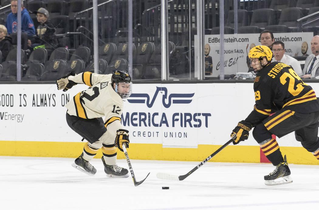 Michigan Tech Huskies defenseman Mark Auk (12) pressures Arizona State Sun Devils defenseman Jakob Stridsberg (29) during the inaugural Ice Vegas Invitational college hockey tournament at T-Mobile ...