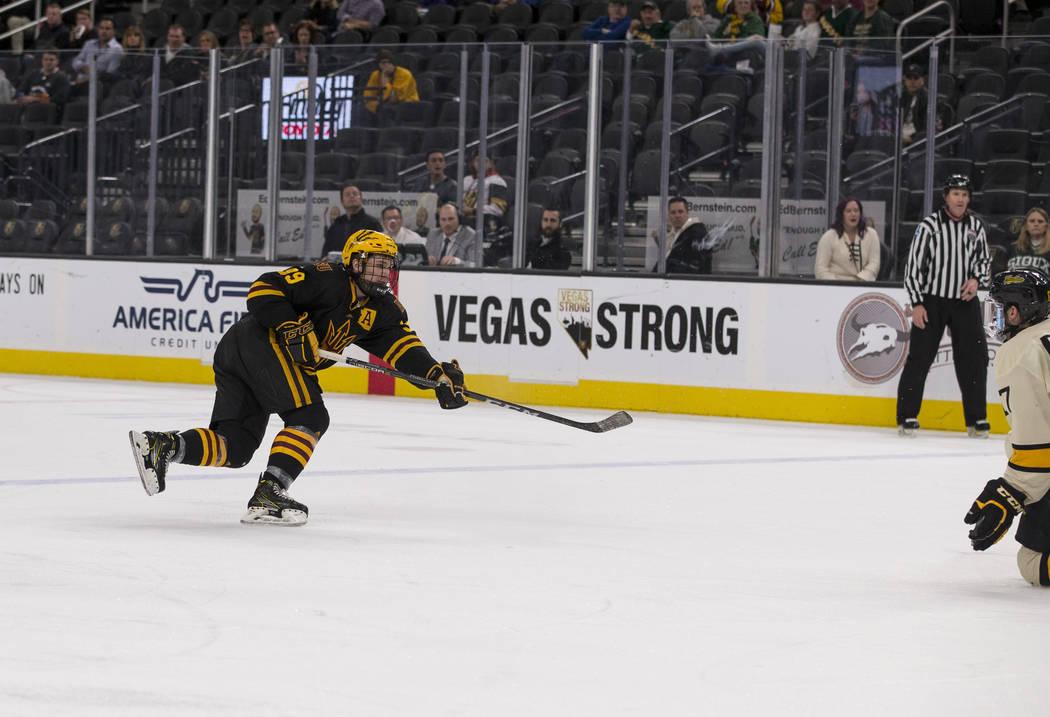 Arizona State Sun Devils defenseman Brinson Pasichnuk (39) takes a slap shot for a goal against the Michigan Tech Huskies during the inaugural Ice Vegas Invitational college hockey tournament at T ...